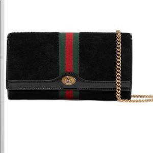 Gucci micro patent leather-trimmed suede bag